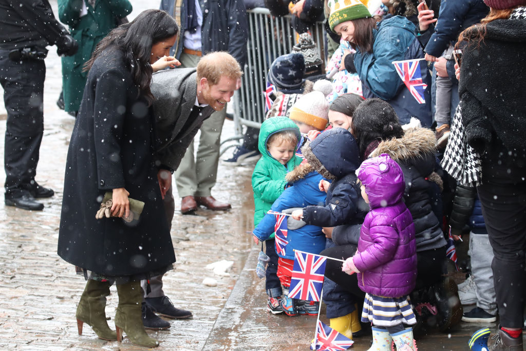 Prince Harry and Meghan Markle with kids