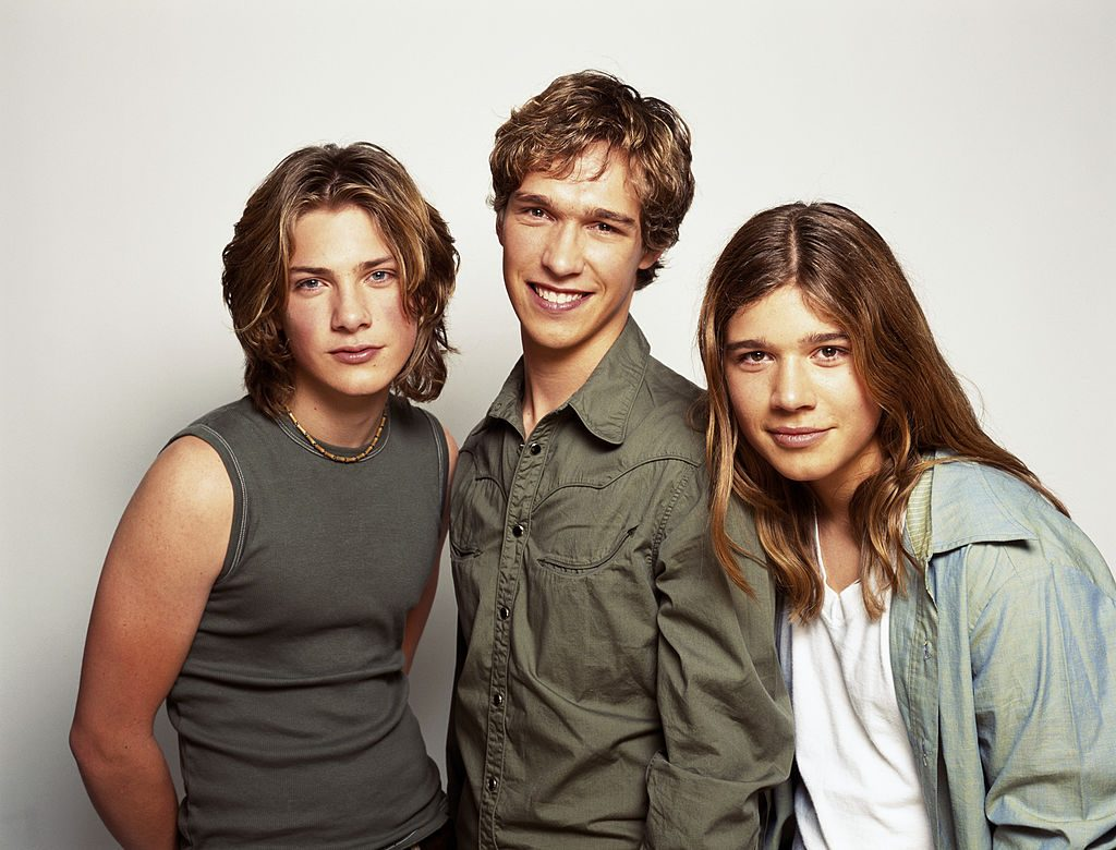 Isaac, Taylor, and Zac Hanson.