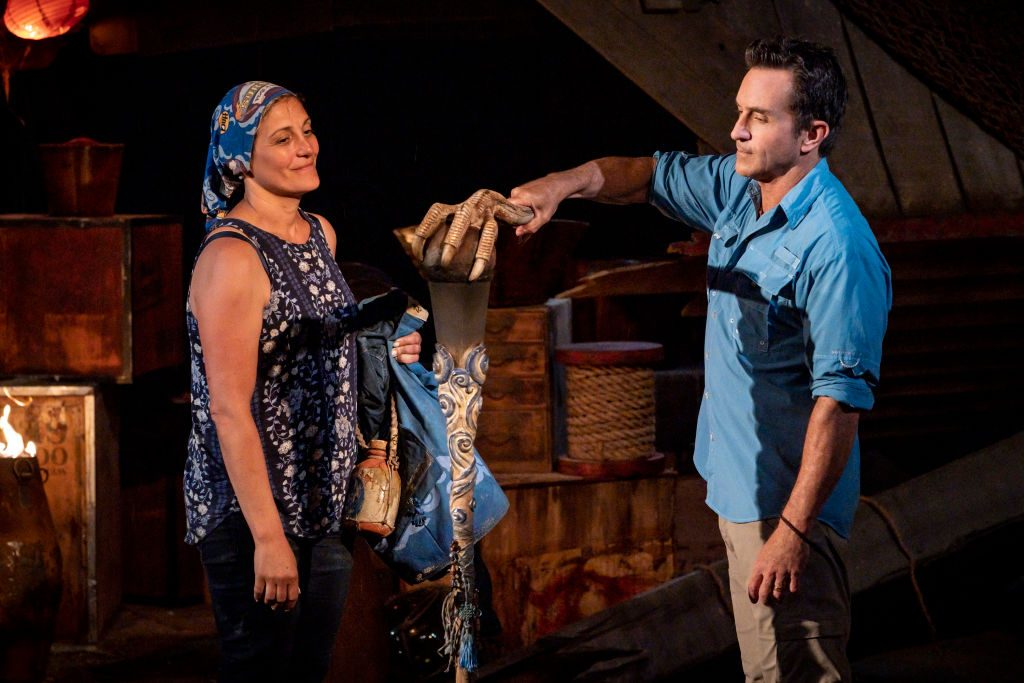 Jeff Probst extinguishes Reem Daly's torch at Tribal Council