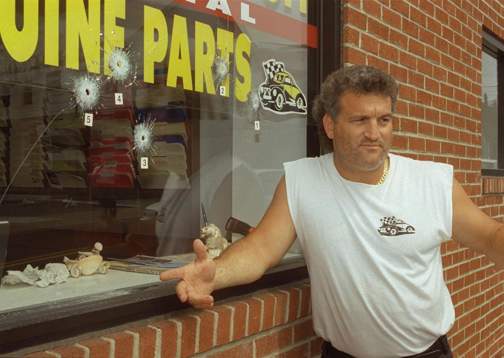 The famous Joey Buttafuoco in front of his family's auto body shop