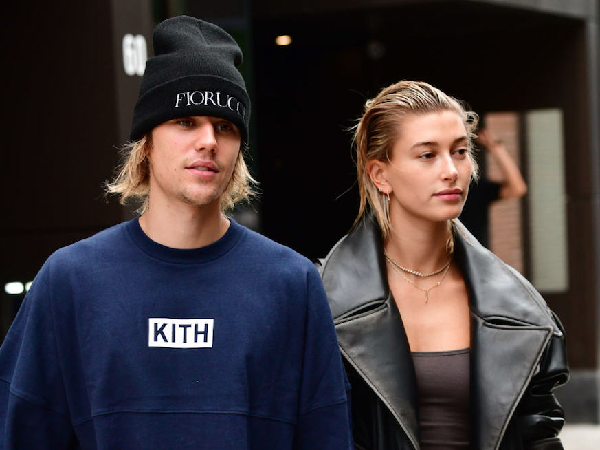 Justin and Hailey together holding hands