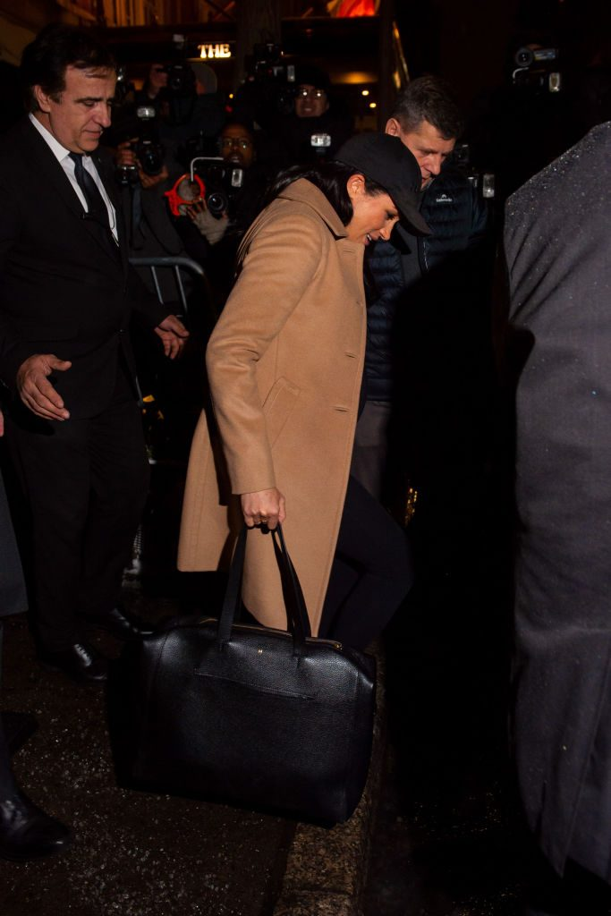Meghan Markle leaves New York City with her bodyguards.