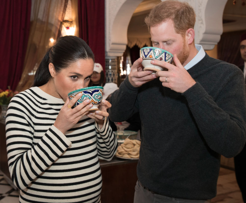 Meghan and Harry trying food