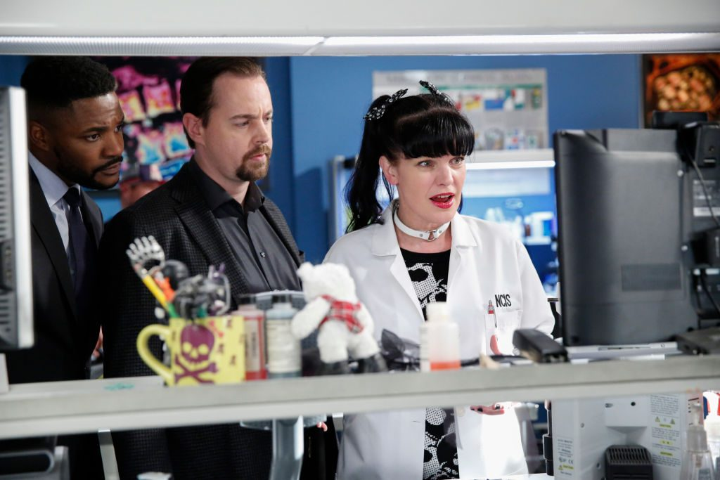 Pauley Perrette as Abby Sciuto on NCIS alongside her castmates | Cliff Lipson/CBS via Getty Images