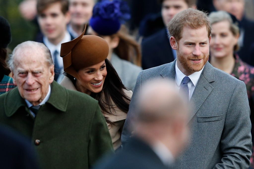 Prince Philip walks with Meghan Markle and Prince Harry