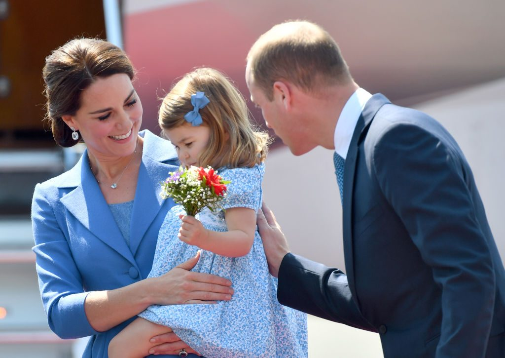 Princess Charlotte with Kate Middleton and Prince William