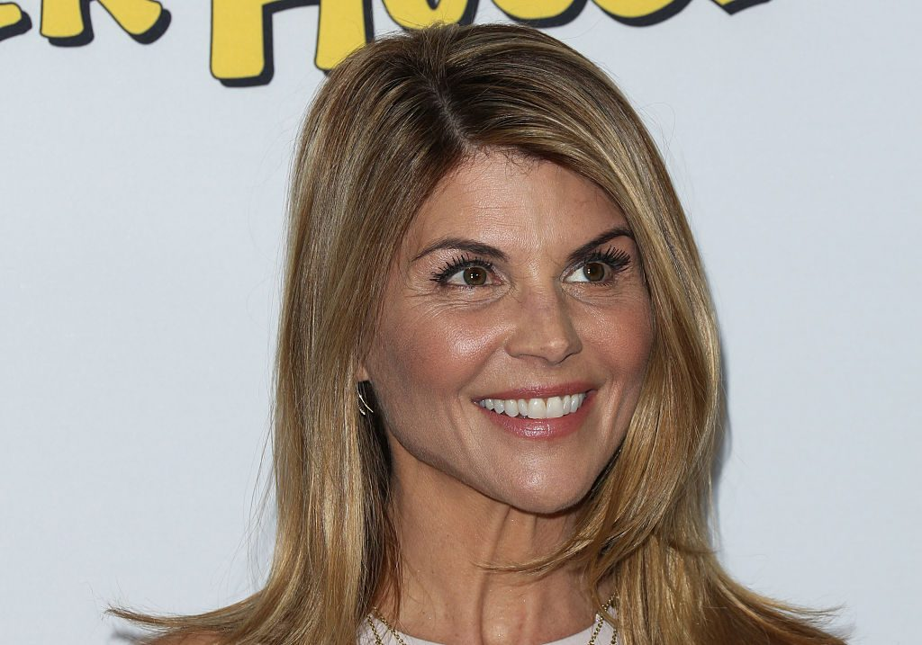 "Lori Loughlin attends the premiere of Netflix's ""Fuller House"" at Pacific Theatres at The Grove on February 16, 2016 in Los Angeles, California."