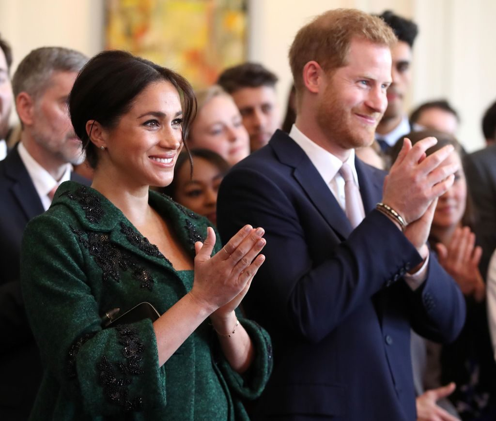 Prince Harry and Meghan Markle watch a musical performance at Canada House