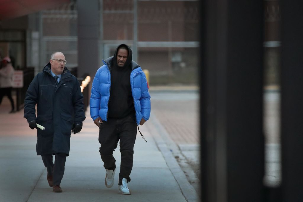 R. Kelly with his lawyer