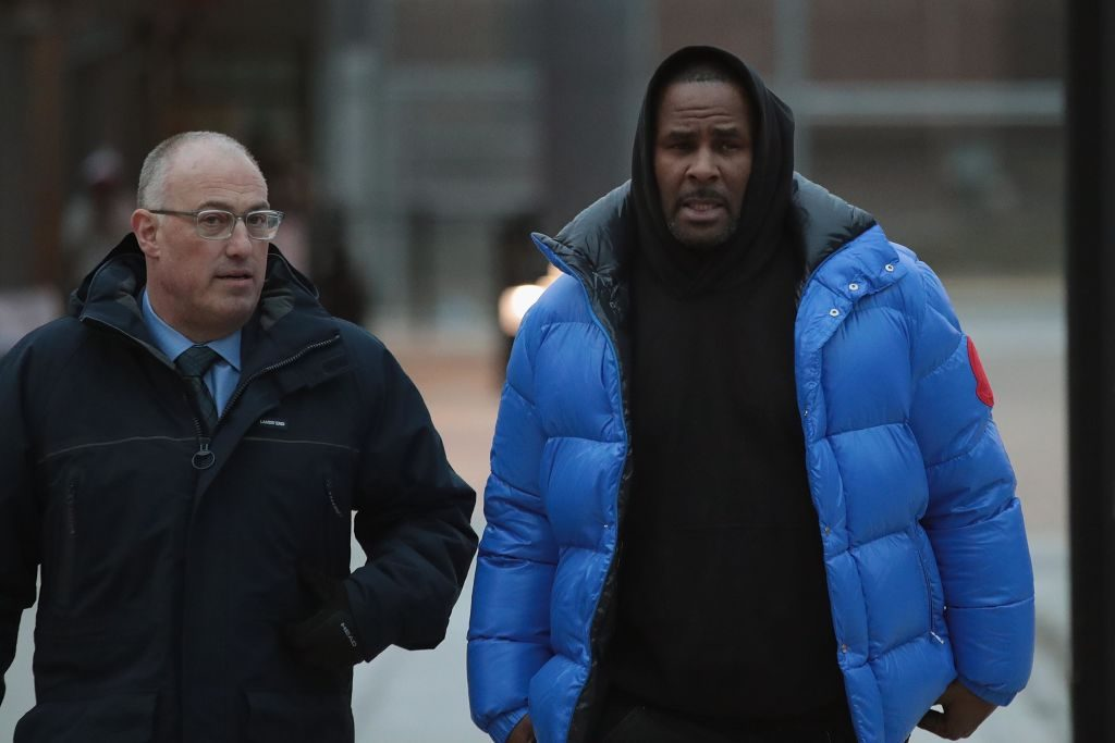 R. Kelly (R) and his attorney Steve Greenberg leave Cook County jail Scott Olson/Getty Images
