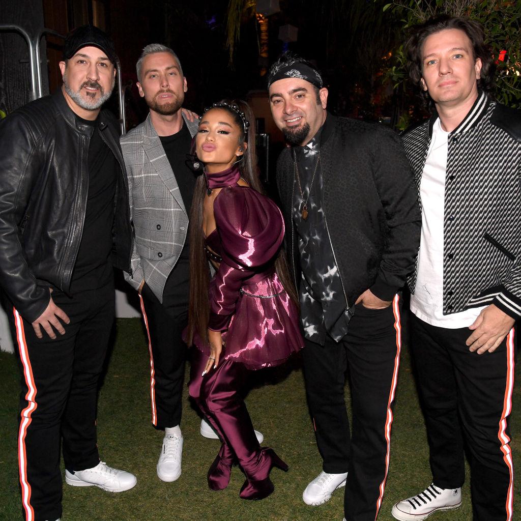 Ariana Grande (C) with members of NSYNC Joey Fatone, Lance Bass, Chris Kirkpatrick, and JC Chasez