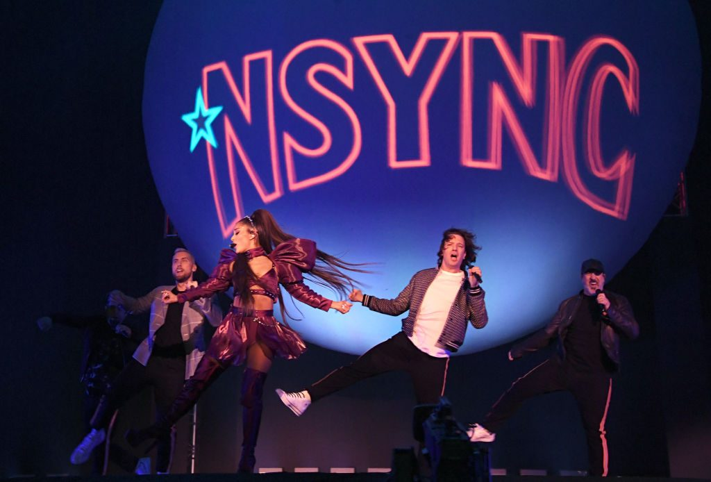 Ariana Grande (C) performs with members of NSYNC