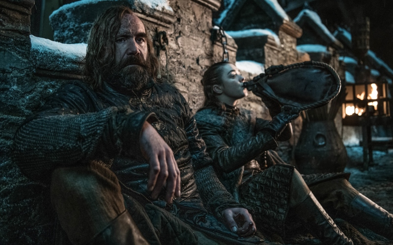 Rory McCann as The Hound and Maisie Williams as Arya Stark on Game of Thrones