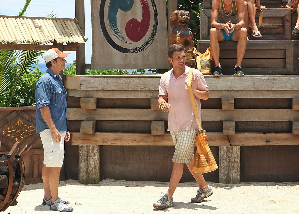 Jeff Probst watches as Colton Cumbie leaves voluntarily