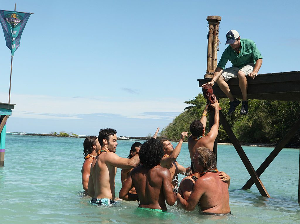 Jeff Probst passes the immunity idol to Colton
