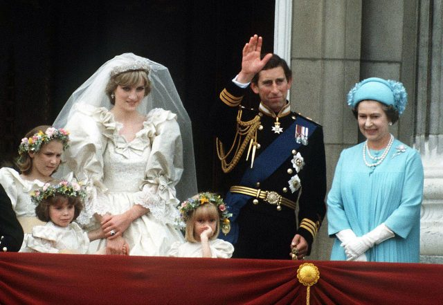 Princess Diana, Prince Charles, and Queen Elizabeth II on Buckingham Palace balcony during wedding.