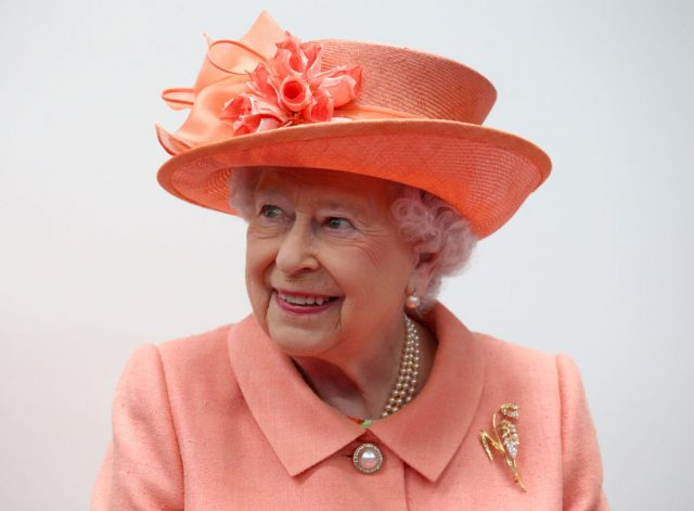 Queen Elizabeth II wearing Botswana Flower brooch.