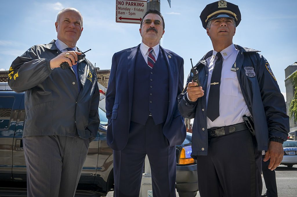 Tom Selleck on the set of Blue Bloods|Mike Pniewski, Tom Selleck, Esai Morales.  (Photo By Jeff Neumann/CBS via Getty Images