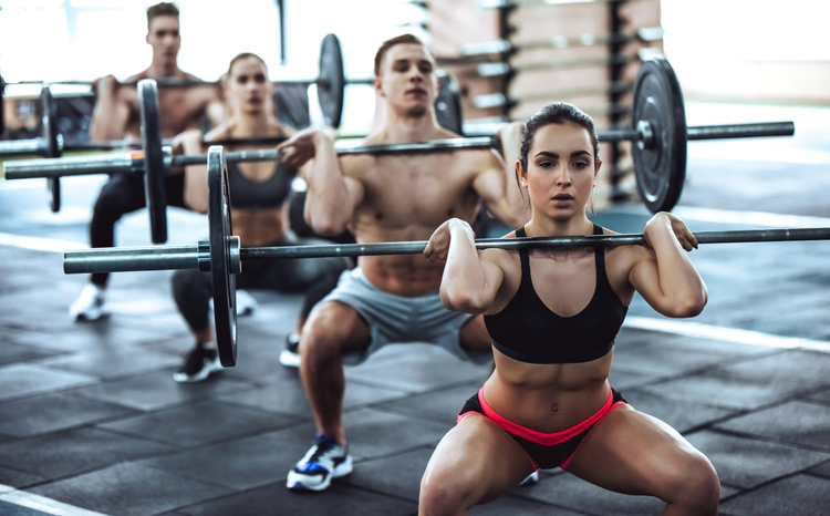 People working out with barbells