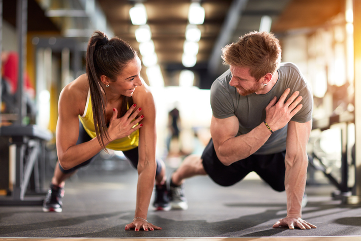 Woman and man training at the gym