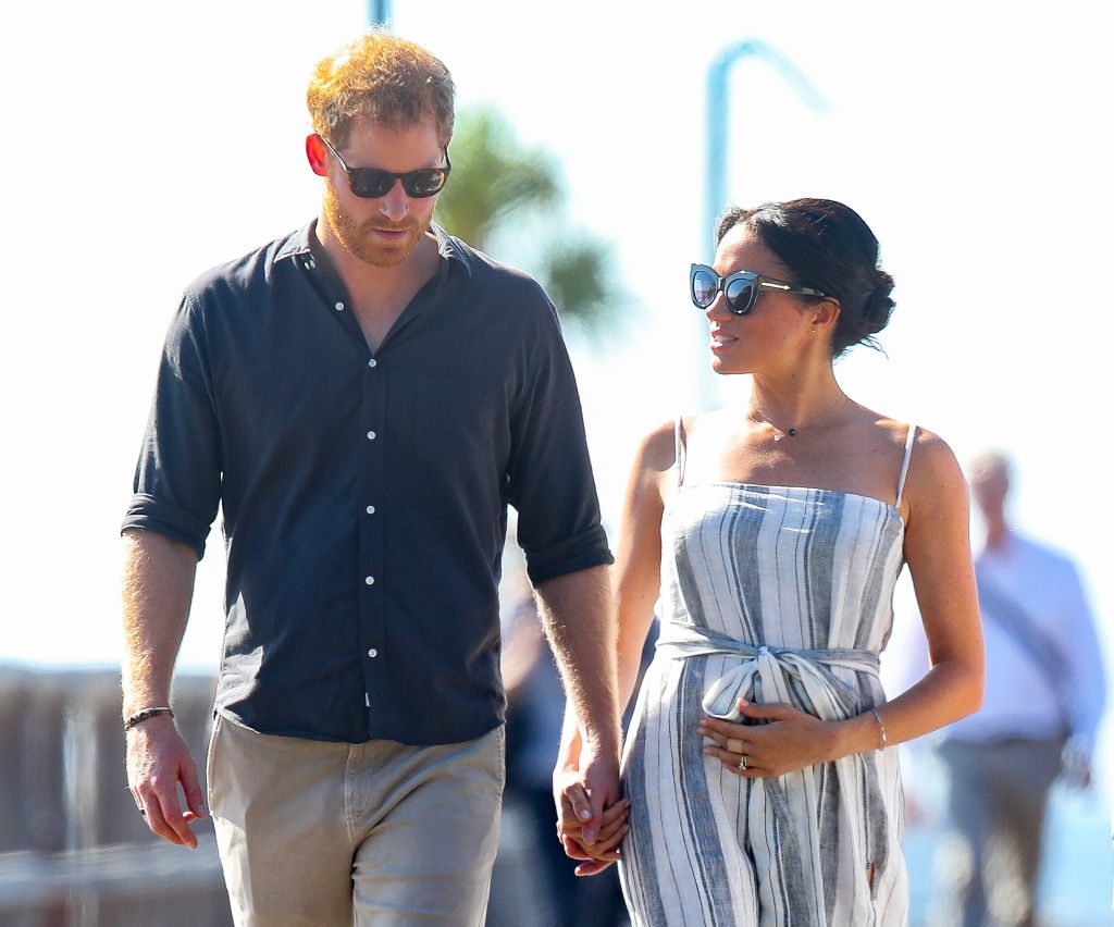 Prince Harry and Meghan Markle walk along a wharf in Kingfisher bay in 2018