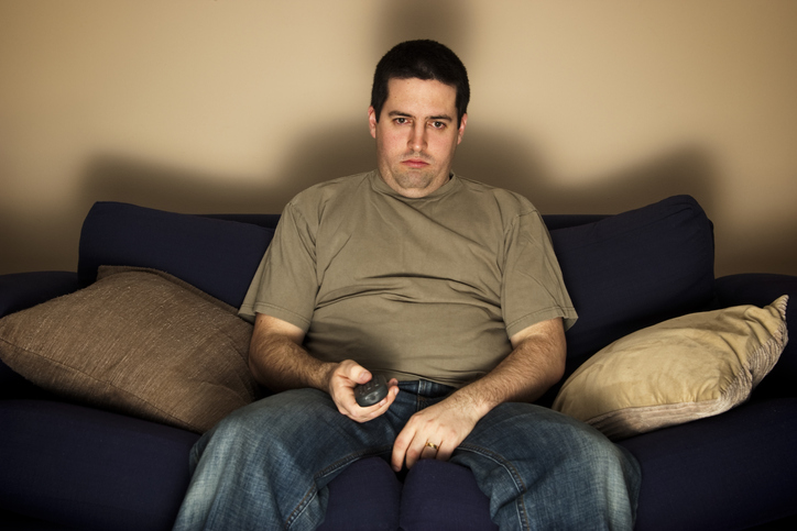 Man watching TV on the couch
