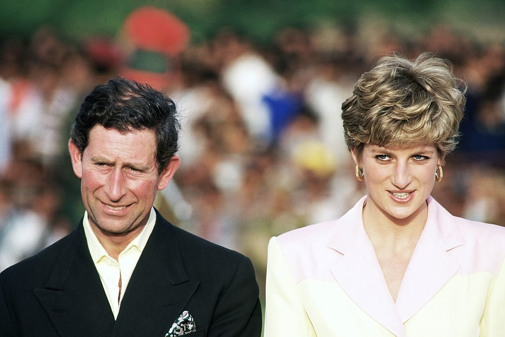 Prince Charles and Princess Diana watch a polo match in Jaipur during a tour of India
