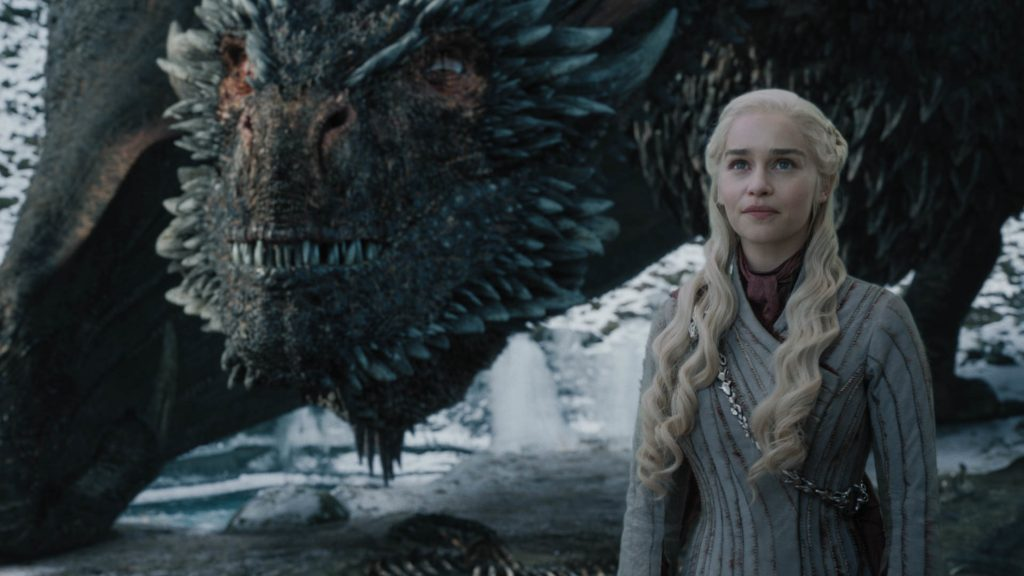 Dany and Drogon pose together