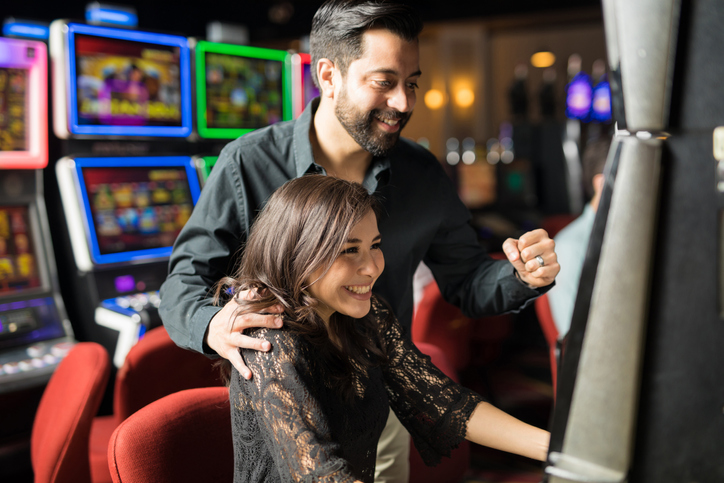 Couple excited over winning on a slot machine