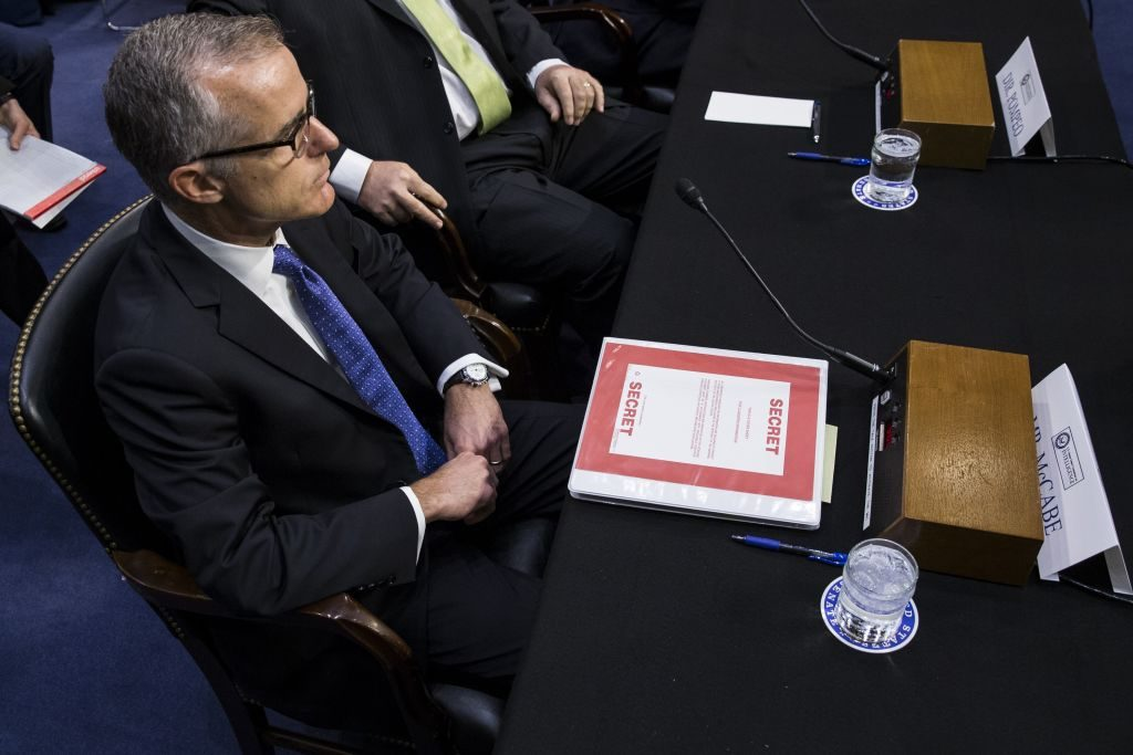 Classified material in front of Andrew McCabe, Acting Director of the FBI