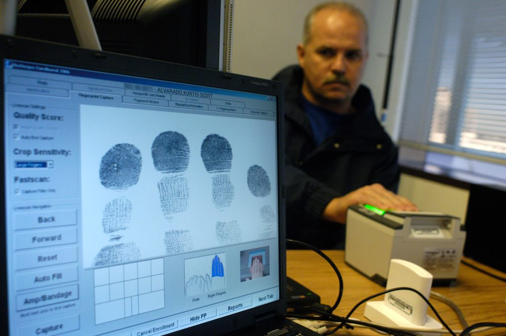 man gets fingerprinted
