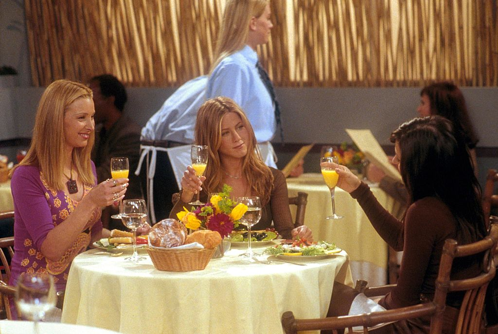 Lisa Kudrow (as Phoebe), Jennifer Aniston (as Rachel) and Courteney Cox (as Monica)