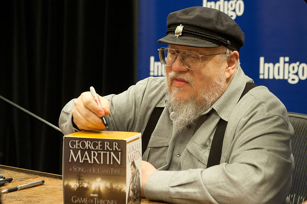 George R.R. Martin signing books.