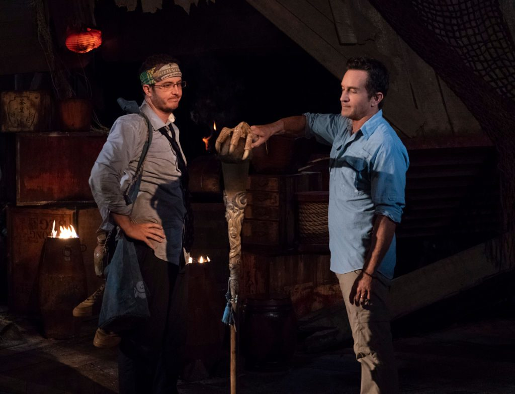 Jeff Probst extinguishes Rick Devens' torch at Tribal Council