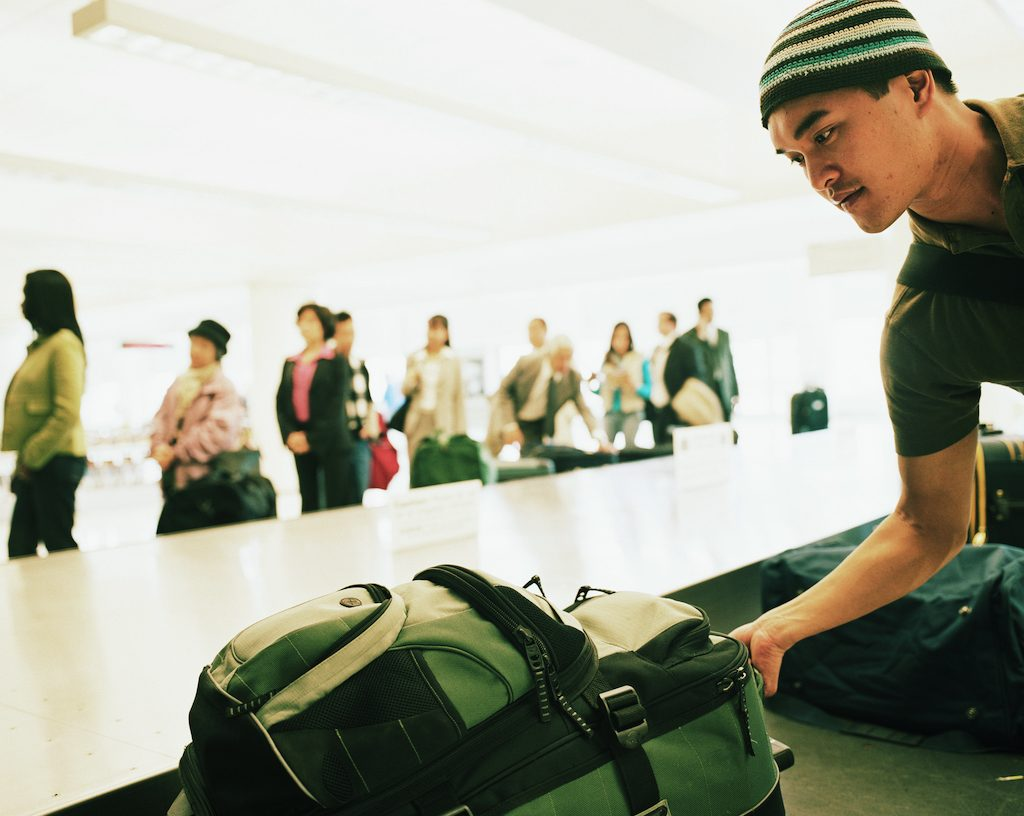 Taking luggage off the carousel