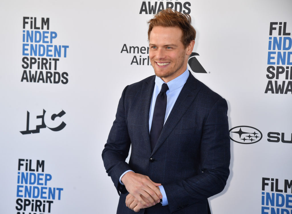 'Outlander' Star Sam Heughan Exposes Fake Profiles Trying To Scam Fans