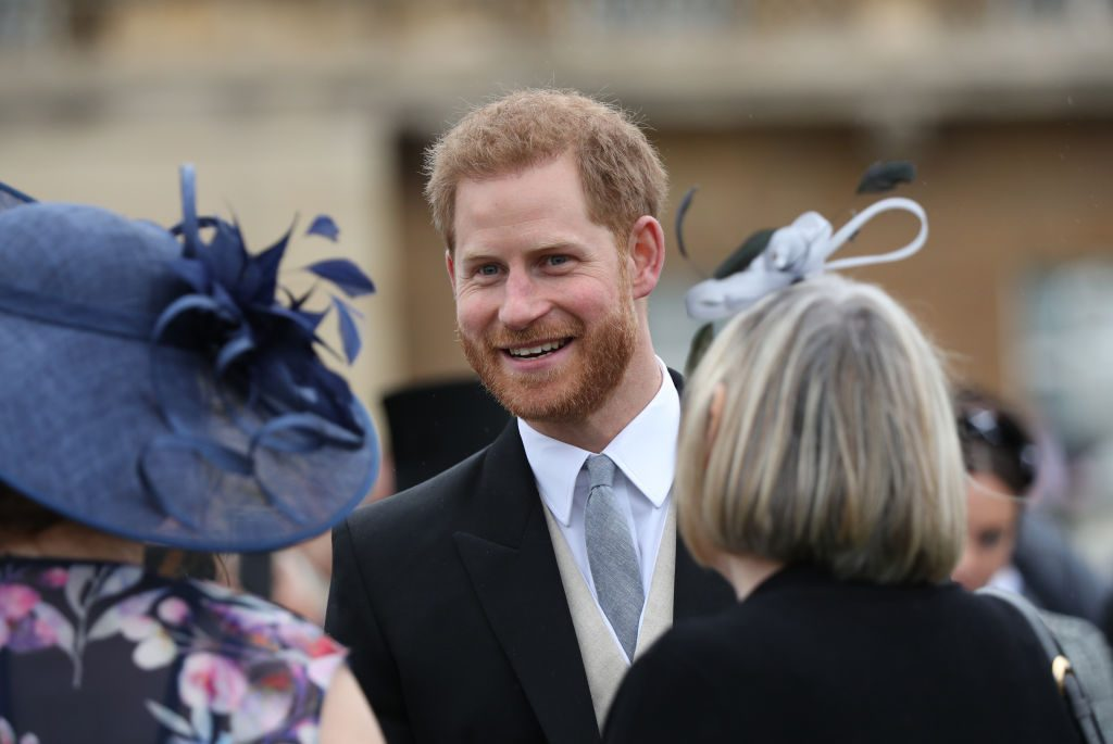 Britain's Prince Harry, Duke of Sussex meets guests at the Queen's Garden Party
