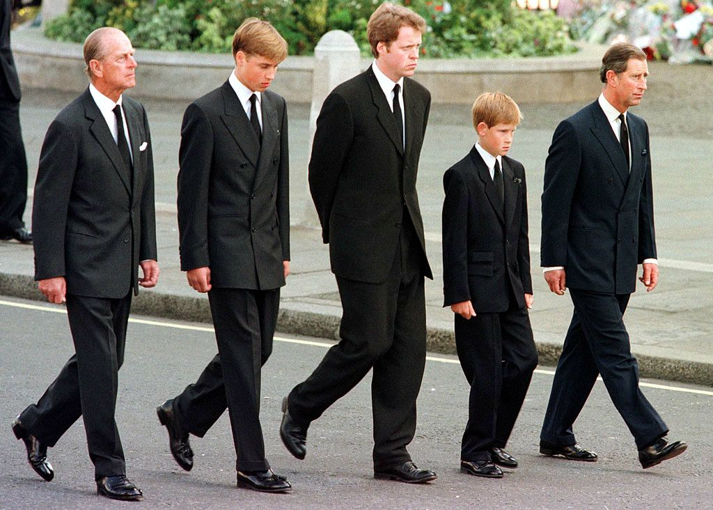Prince Philip, Prince William, Earl Spencer, Prince Harry and Prince Charles walk outside Westminster Abbey during the funeral service for Diana