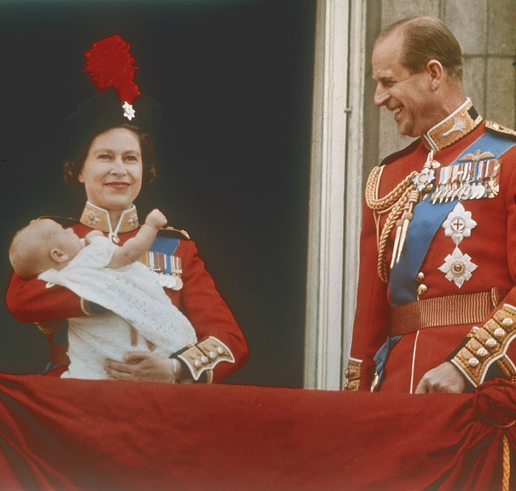 Queen Elizabeth II holding Prince Edward next to Prince Philip