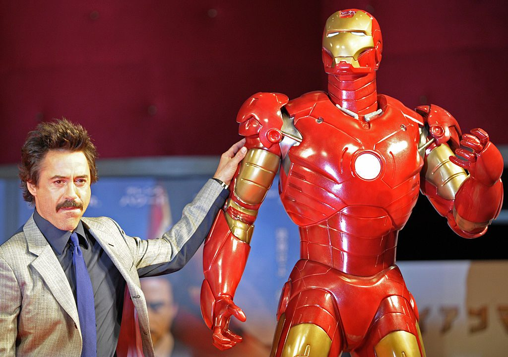 Robert Downey Jr. posing next to Iron Man |  Kitamura/AFP/Getty Images