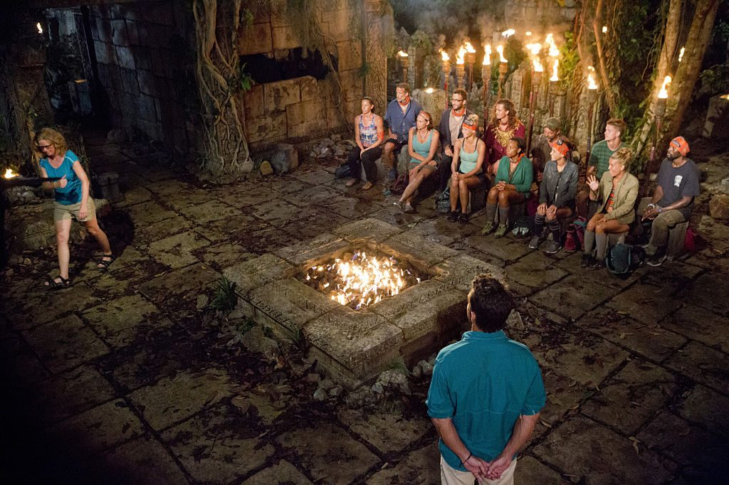 Jeff Probst and the other survivors watch Kass McQuillen head to the jury