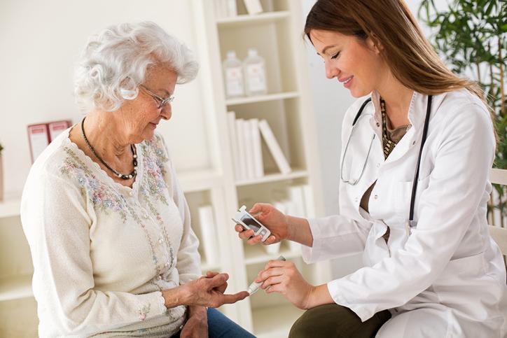 Senior patient getting a blood sugar test