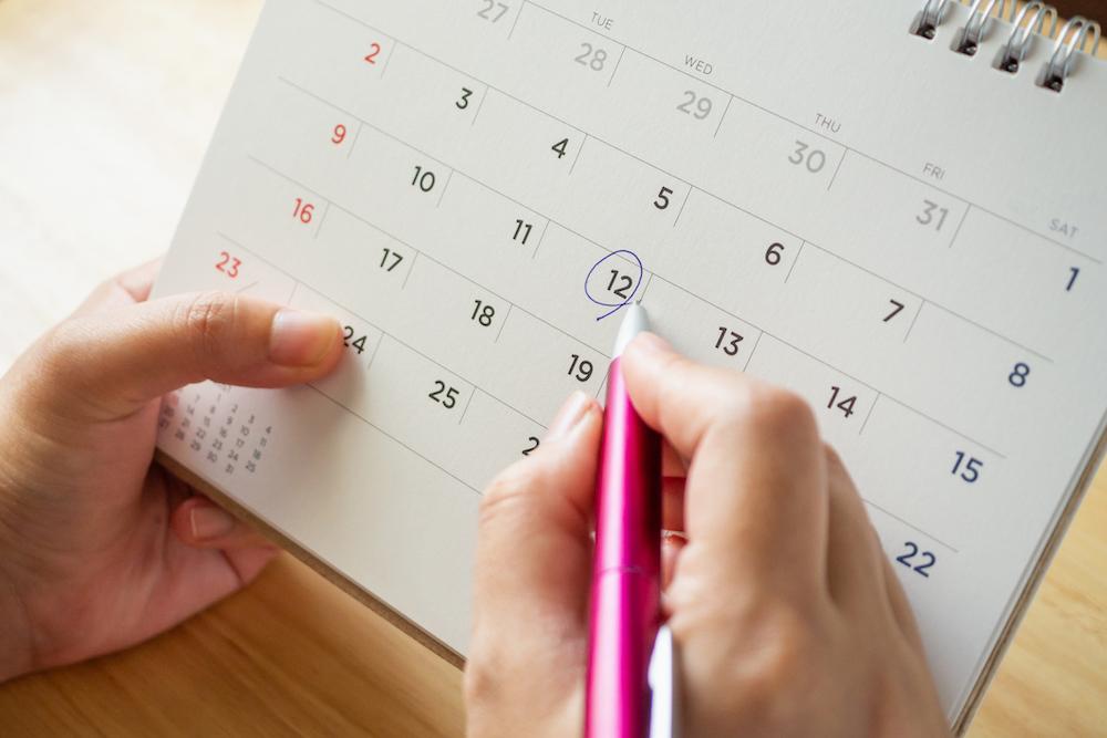 Hands holding a calendar