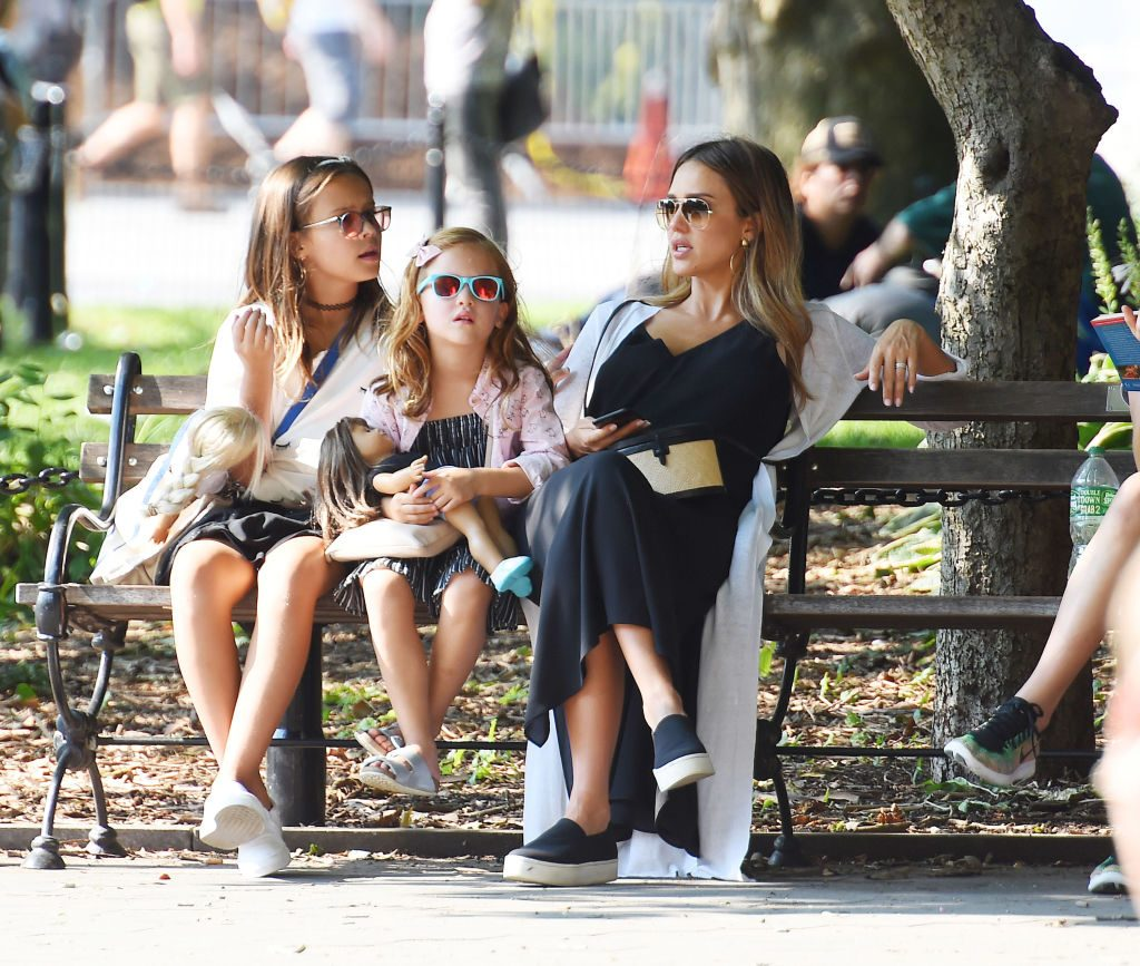 (Left to right): Honor Warren, Haven Warren, and Jessica Alba on a park bench