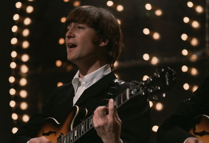 John Lennon performing on stage