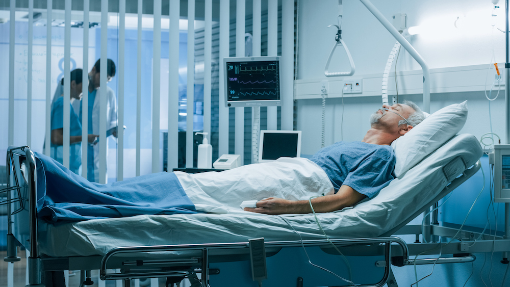 Man laying in a hospital bed after surgery