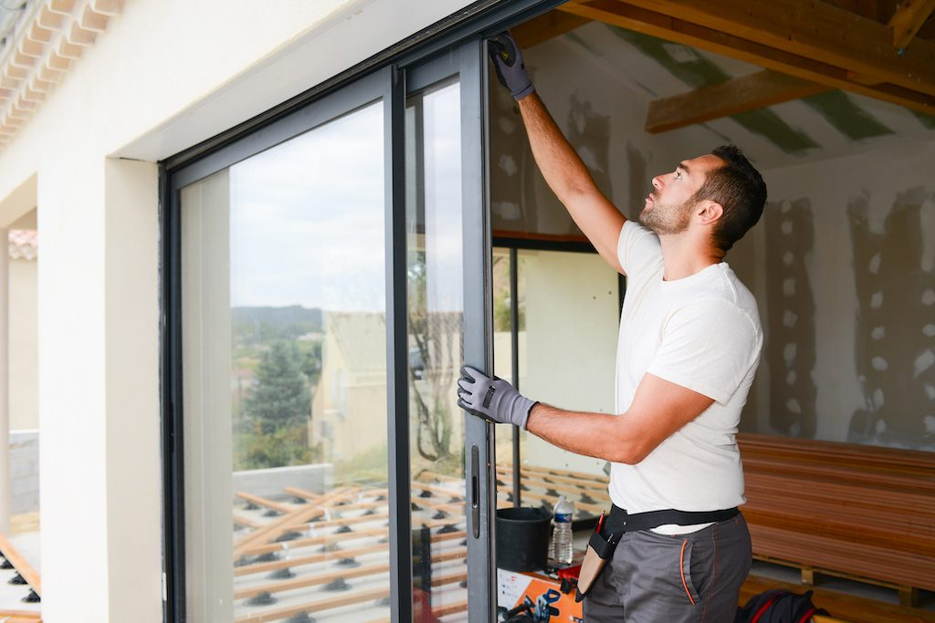man installing bay window