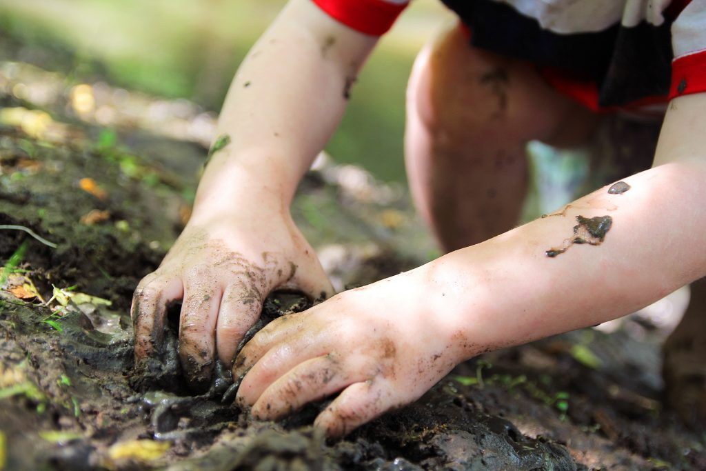 Kid playing in the dirt