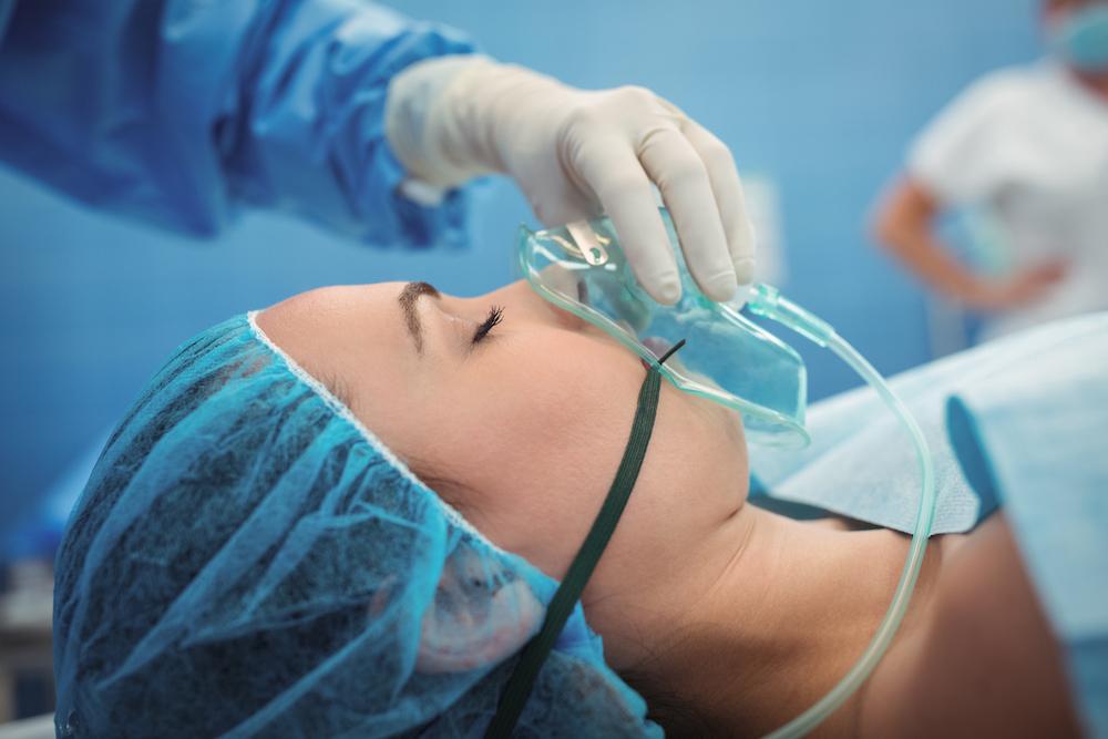 Patient wearing an oxygen mask