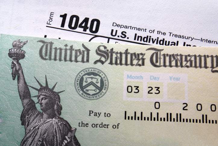 Close up of tax return check sitting on 1040 form